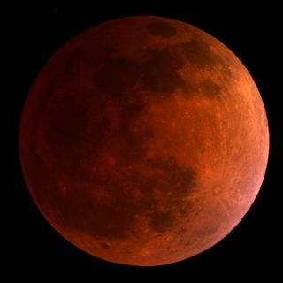 he moon turns blood red in this 3:30 a.m. ET view of the total lunar eclipse on April 15, 2014 as seen by a telescope at the University of Arizona's Mt. Lemmon SkyCenter at Steward Observatory atop Mt. Lemmon, Arizona.