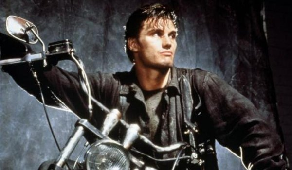 The Punisher Dolph Lundgren scowling on a motorcycle