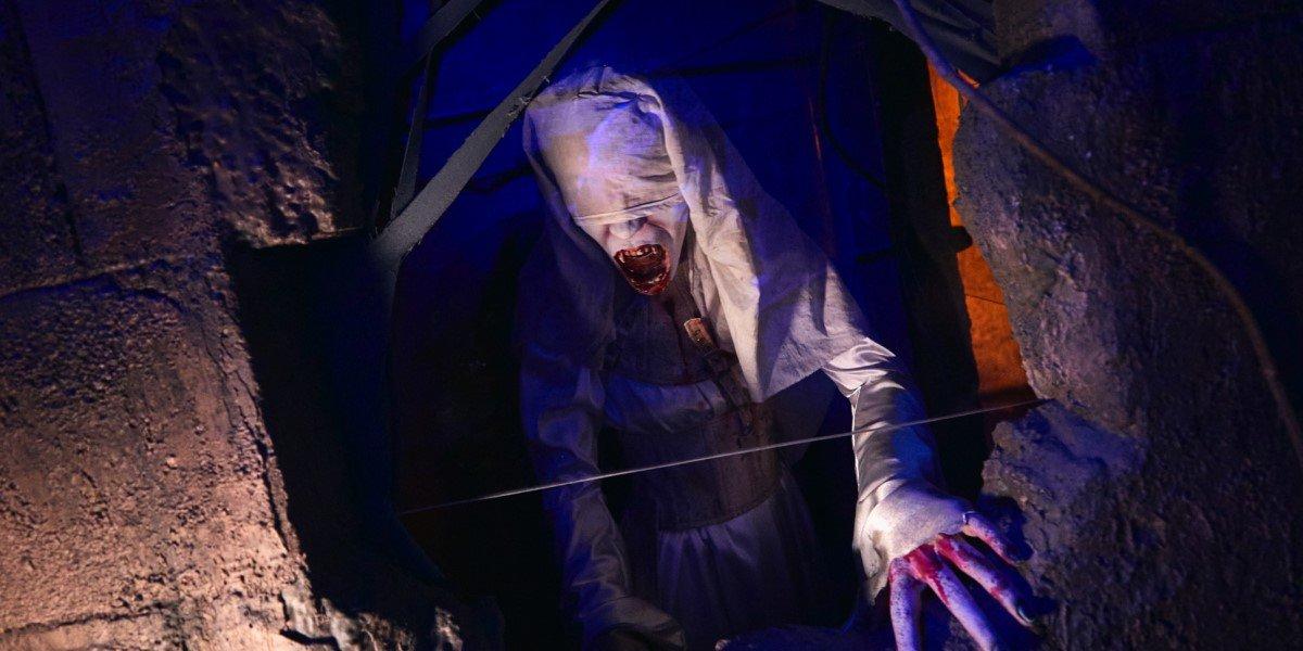 one of draculas brides in bride of frankenstein haunted maze at universal studios orlando halloween horror nights