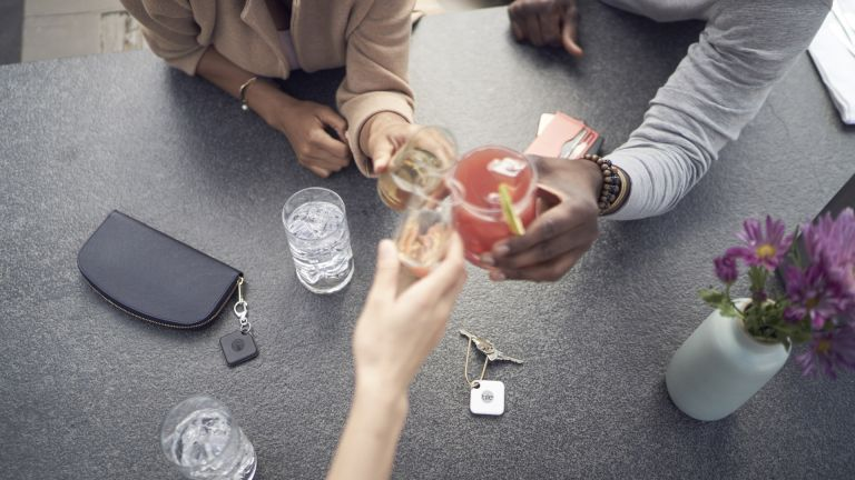 Tile Pro being used on purses and keys with friends having drinks