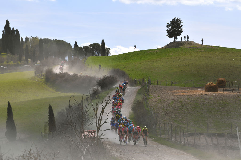 SIENA ITALY MARCH 09 Landscape Peloton Dust during the Eroica 13th Strade Bianche 2019 a 184km race from Siena to SienaPiazza del Campo StradeBianche on March 09 2019 in Siena Italy Photo by Tim de WaeleGetty Images