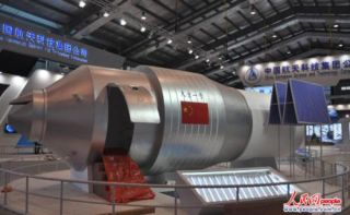 Display model of Tiangong I module at an exhibition hall at the China Academy of Space Technology, complete with access door for public viewing.