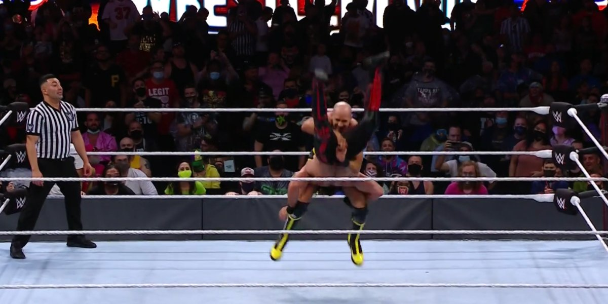 Cesaro performing the Neutralizer on Seth Rollins at WrestleMania 37