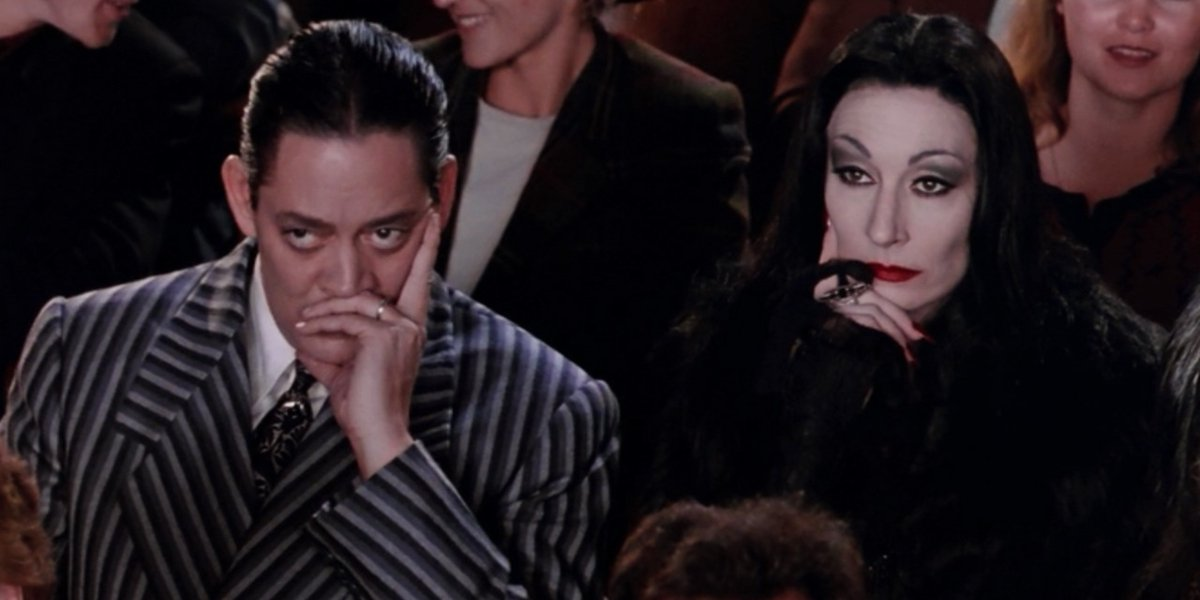 Raul Julia and Anjelica Huston in The Addams Family