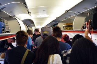 Passengers exiting airplane