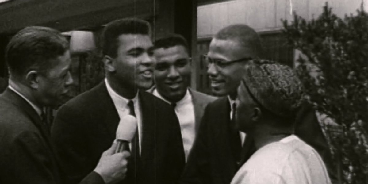 Archival footage of Cassius Clay and Malcolm X giving an interview in Blood Brothers: Malcolm X and Muhammad Ali