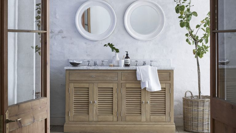 Traditional powder room ideas with classic washstand by Neptune