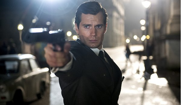 The Man From U.N.C.L.E. Henry Cavill takes aim in the streets of Berlin
