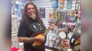 Tom Araya plays mandolin in Dublin