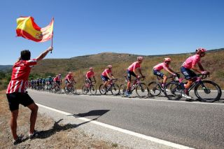 ESPINOSA DE LOS MONTEROS SPAIN AUGUST 16 A general view of Jonathan Klever Caicedo Cepeda of Ecuador Diego Andres Camargo Pineda of Colombia Simon Carr of United Kingdom Hugh Carthy of United Kingdom Magnus Cort Nielsen of Denmark Lawson Craddock of United States Jens Keukeleire of Belgium Thomas Scully of New Zealand and Team EF Education Nippo and the peloton while fans cheer during the 76th Tour of Spain 2021 Stage 3 a 2028km stage from Santo Domingo de Silos to Espinosa de los Monteros Picn Blanco 1485m lavuelta LaVuelta21 CapitalMundialdelCiclismo on August 16 2021 in Espinosa de los Monteros Spain Photo by Gonzalo Arroyo MorenoGetty Images