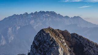 hiking in Italy: hiker looking across to Resegone