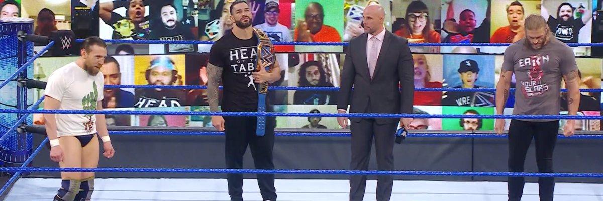 Daniel Bryan, Roman Reigns, Adam Pearce, and Edge on SmackDown