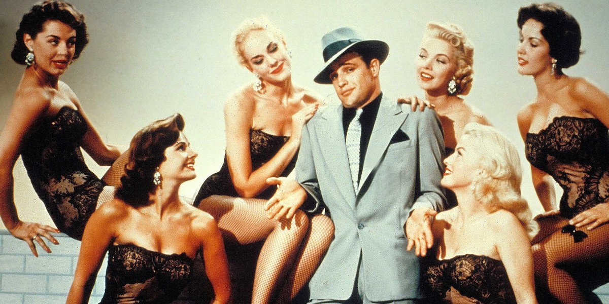 Marlon Brando and an ensemble of women in 1955 Guys and Dolls movie
