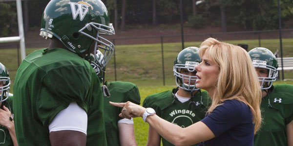 Sandra Bullock takes over as coach for Aaron Quinton in The Blind Side