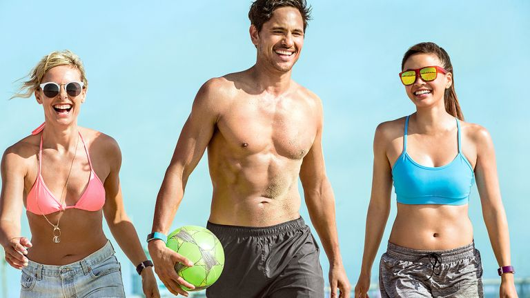 Three fit and toned people taking part in sport