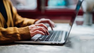 Best laptops for programming: woman at laptop