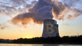 Stock image of nuclear plant with bitcoin logo