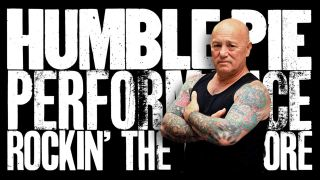 Angry Anderson standing in front of the artwork for Humble Pie's Performance: Rockin' The Fillmore