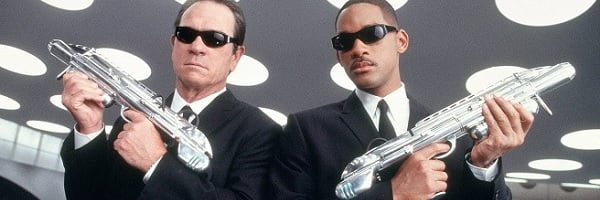Men In Black Tommy Lee Jones Will Smith Agents K and J pose with guns.