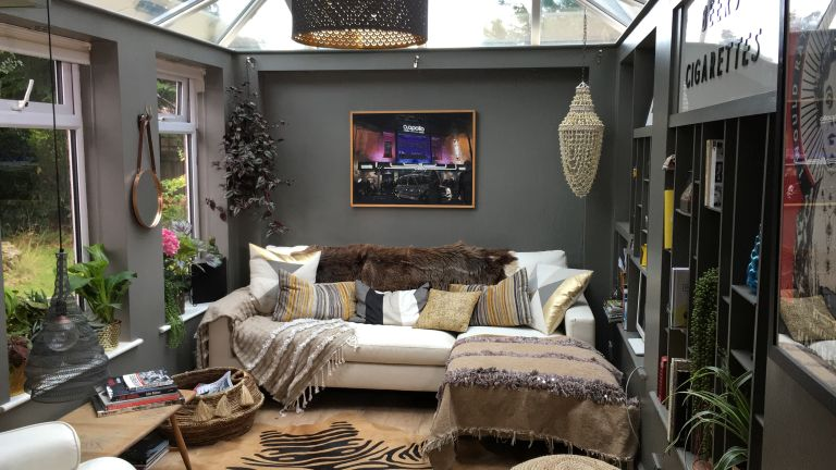 a conservatory that has been transformed into a cosy snug or living room