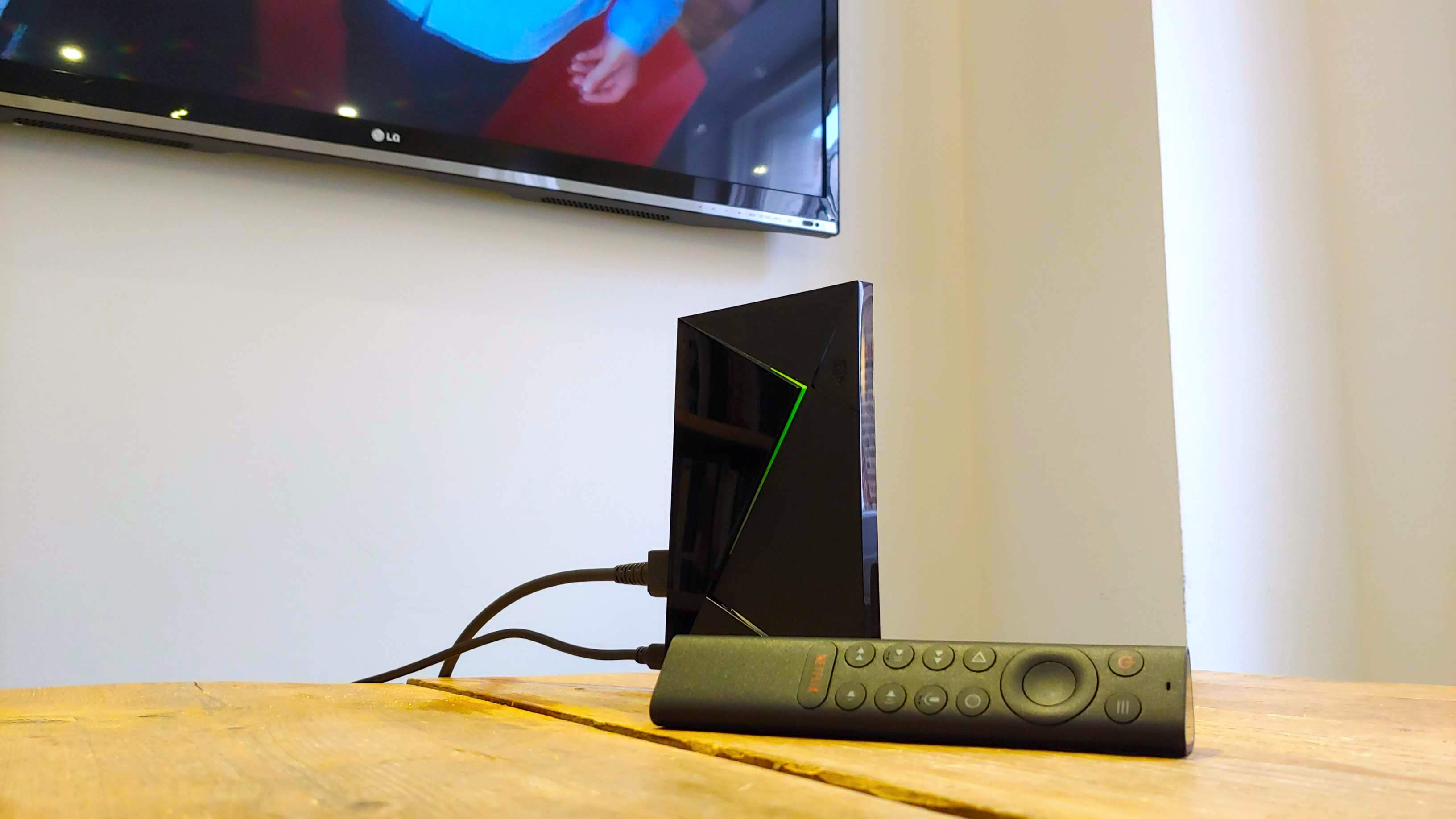 The Nvidia Shield TV Pro all wired up, with the remote in the foreground
