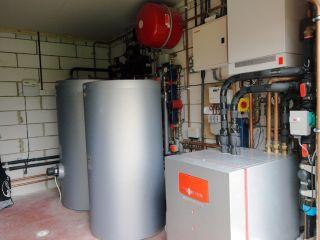 a plant room containing a heat pump unit