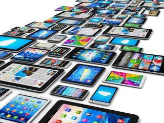 Array of various mobile devices with colorful screens