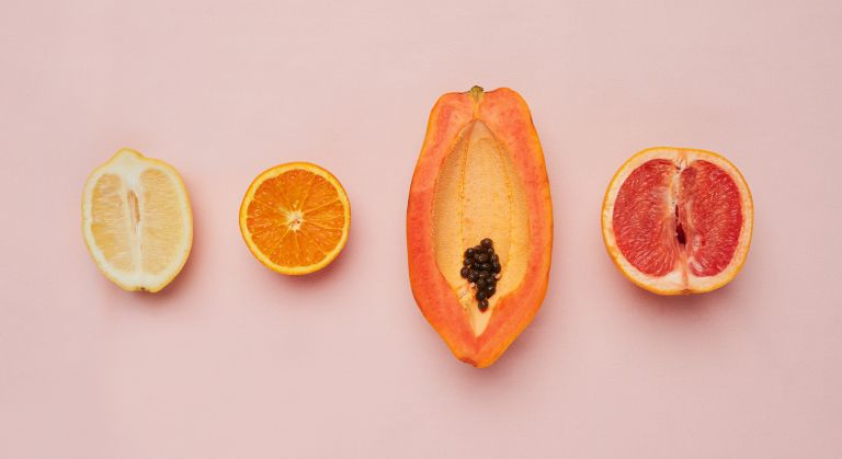 A row of soft fruit on a pink background