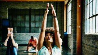 7 Types of yoga: Image shows woman doing yoga pose