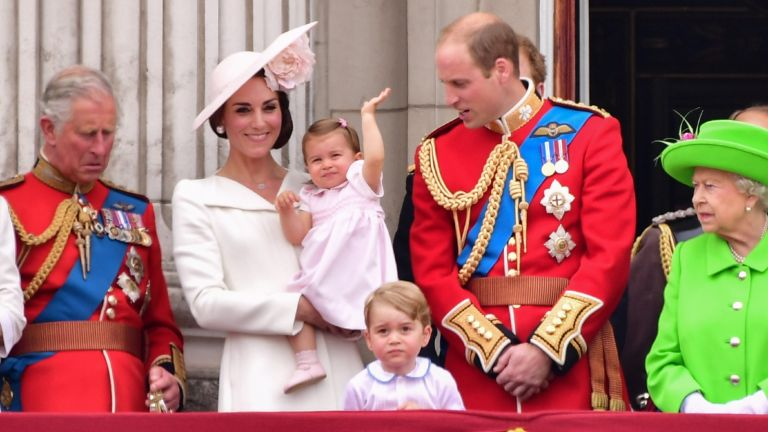 Charles, Prince of Wales, Catherine, Duchess of Cambridge, Princess Charlotte, Prince George and Prince William, Duke of Cambridge and Queen Elizabeth II stand on the balcony during the Trooping the Colour,
