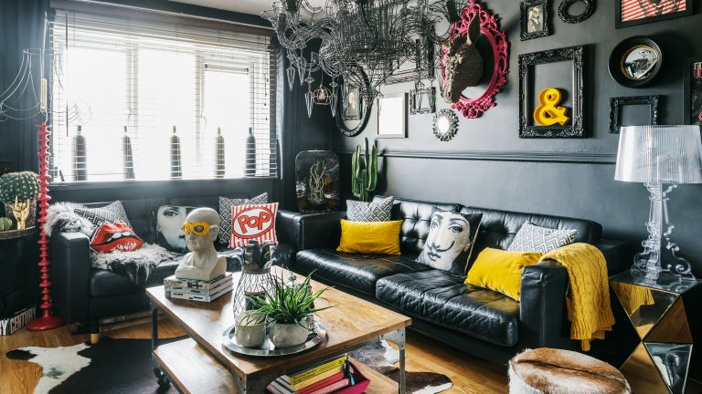 DIY Makeover Living room with dark paint, sofa and chandelier