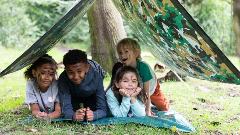 garden activities for kids: the den kit cover with four kids