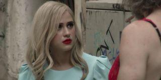 Borat Subsequent Moviefilm Maria Bakalova in an alley, looking a bit sad
