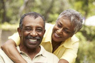 A smiling, happy senior couple.