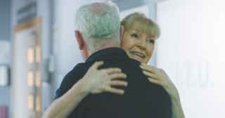 Duffy and Charlie hug in happier times