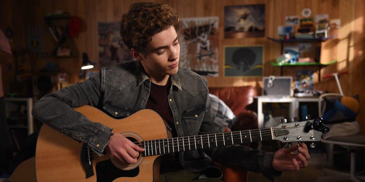 Joshua Bassett on the guitar as Ricky in High School Musical series