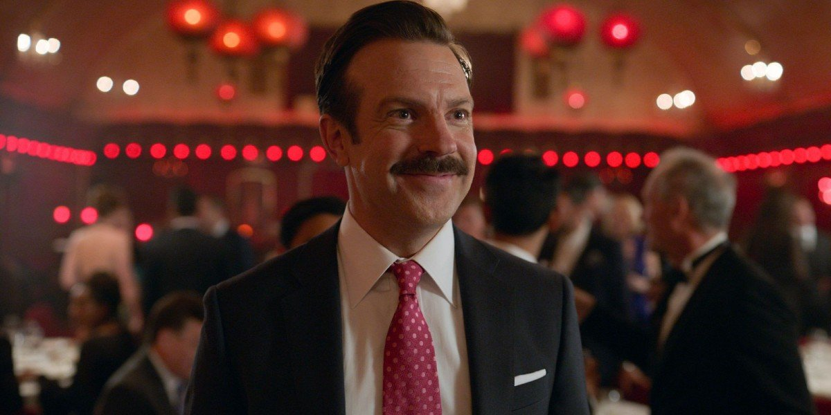 Ted Lasso (Jason Sudeikis) smiles in Ted Lasso