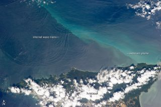 This photograph, taken on Jan. 18 by a crewmember on the International Space Station, shows internal waves north of the Caribbean island of Trinidad.
