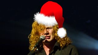 A picture of Dave Mustaine wearing a Santa Claus hat