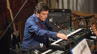 John Hackett playing keyboards in a church
