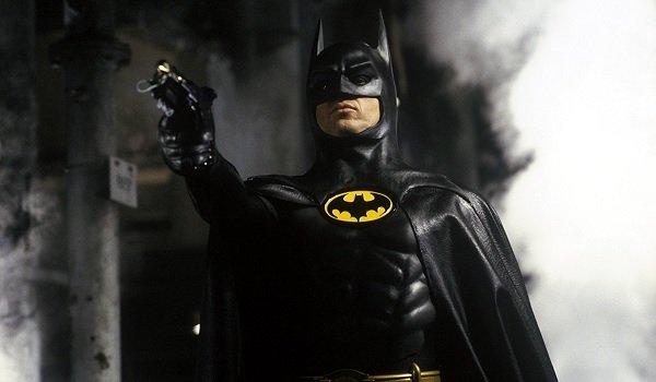 Batman Michael Keaton ready to fire a grappling gun