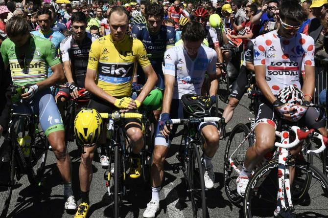Chris Froome and the other riders respect a minutes silence before the start of stage 14