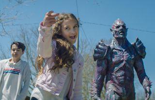Nita-Josee Hanna, Owen Myre, and Psycho Goreman in 'Psycho Goreman.'