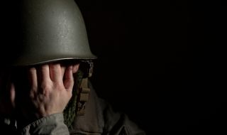 soldier covering face, ptsd, post-traumatic stress, shell shock
