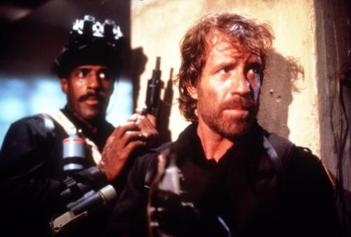 Delta Force - Chuck Norris's commando Scott McCoy gets ready for more ass-kicking action in the 1986 action film.