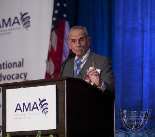 Leon Esterowitz at a podium.