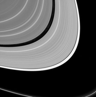 Saturn's rings part ways for the planet's moon Pan in this image taken July 2, 2016 by the Cassini spacecraft. The moon holds open the Encke Gap in Saturn's A ring, a 200-mile (325 kilometer) wide opening.