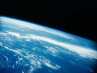 Scientists think that clouds could exacerbate warming global termperatures. In this image you can see astronaut Alan B. Shepard, Jr.'s view of Earth that no American had seen before, looking down on the home planet from his history-making suborbital flight on May 5, 1961.