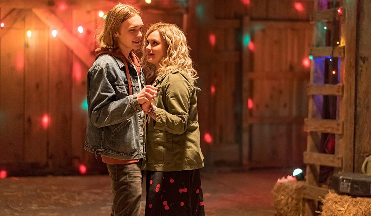 Charlie Plummer and Katherine Langford dancing in a barn in Spontaneous.