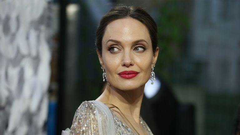 "US actress Angelina Jolie poses on the red carpet upon arrival for the European premiere of the film ""Maleficent:Mistress of Evil"" in London on October 9, 2019. (Photo by ISABEL INFANTES / AFP) (Photo by ISABEL INFANTES/AFP via Getty Images)"